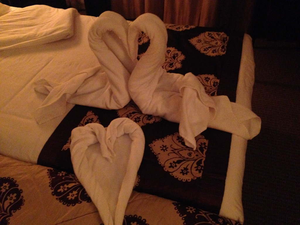 Towel creation with swan and heart